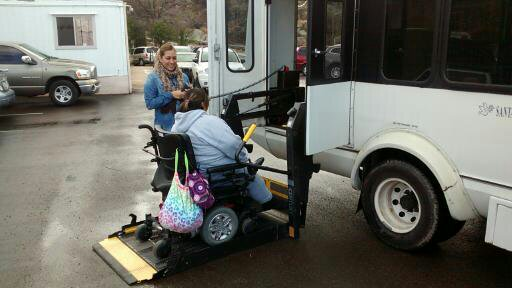 Providing a transportation lift for an adult with a walking disability.