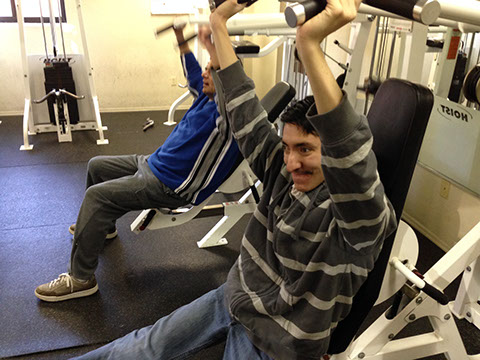 Gym training to help an adult with disabilities